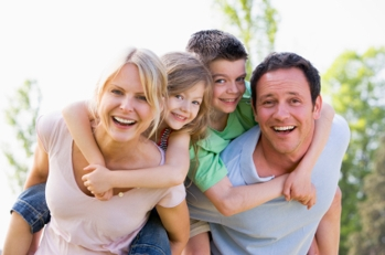 Happy healthy family of 4 smiling